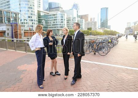 Male Boss Speaking With Business Team Members In La Defense Paris. Concept Of Biz Employees And Deci