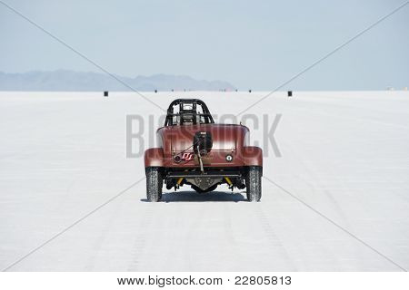 WENDOVER, UT - AUGUST 13: A hot rod races on the Bonneville Salt Flats during Bonneville Speed Week on August 13, 2011 near Wendover, UT.