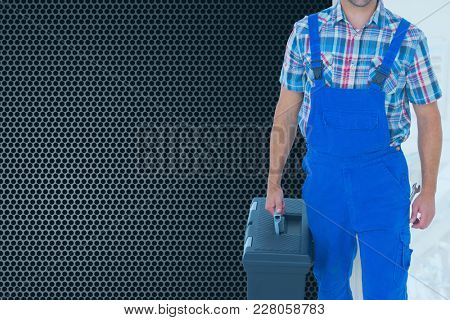 Digital composite of Composite image of man holding a toolbox