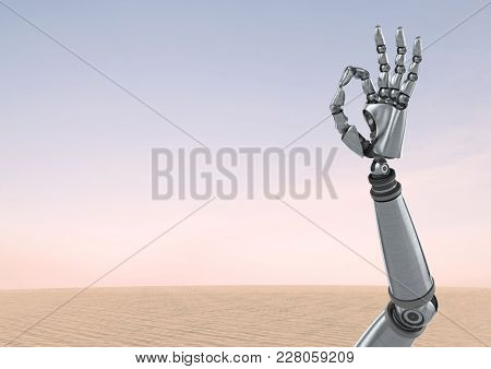 Digital composite of Android Robot hand gesture OK with desert sky background