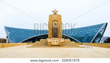 Baku, Azerbaijan - January 01, 2018: Monument of soviet hero general Hazi Aslanov with modern construction on the background, Baku, Azerbaijan