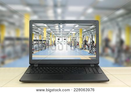 Interior of a fitness hall with a girl on the background