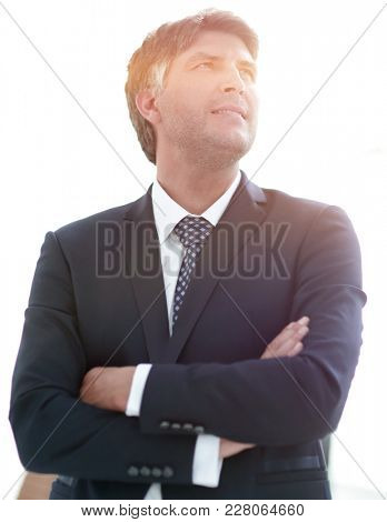 Photo of an attractive businessman with his arms crossed