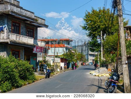 POKHARA, NEPAL - CIRCA NOVEMBER 2017: A street with the Machapuchare in the background.