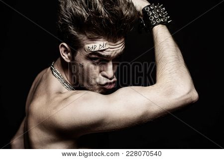 Fight club, MMA. Portrait of a bad guy fighter demonstrating his muscles and strength. Rocker, punk.