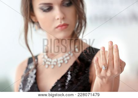 Beautiful young woman with elegant ring, closeup