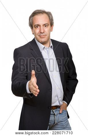 mature casual man offering to shake the hand, isolated