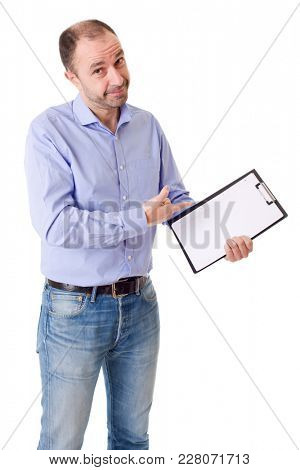 friendly young man pointing to a sheet and looking into the camera. isolated on white background