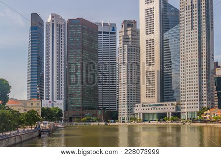 Singapore City, Singapore - 07 19 2015: Singapore Reflection Of Modern High Skyscraper Buildings And Its River At Day.