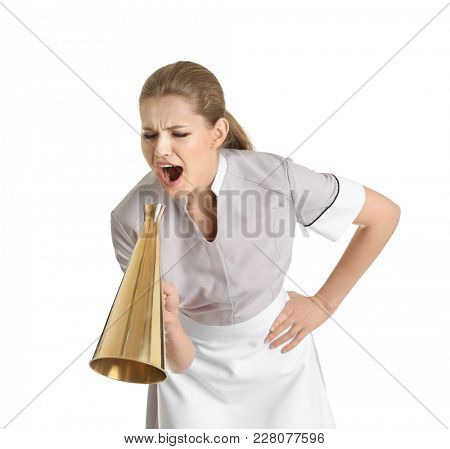 Young chambermaid shouting into megaphone on white background