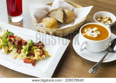 Lunch On The Table: Tomato Puree Soup, Salad Of Fresh Vegetables And Sun-dried Tomatoes And Bread