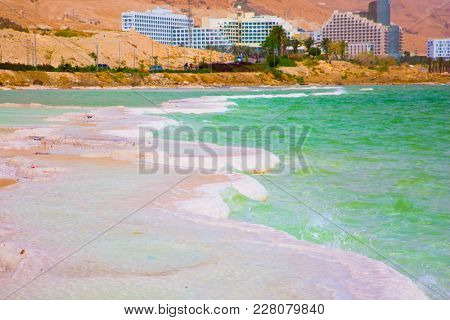 Picturesque islands of medicinal salt in the lake. Israel, spring. Forever Living Dead Sea. The concept of ecological and medical tourism