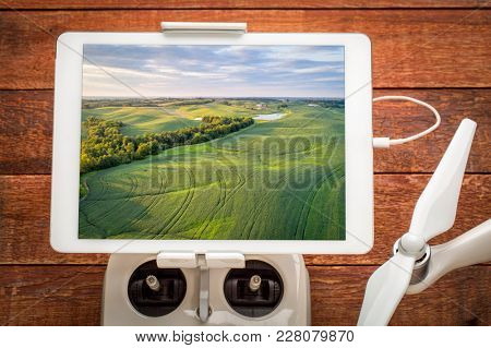 green soy fields in Missouri - reviewing aerial image on a digital tablet mounted on a drone radio controller