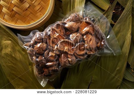 Dried Shiitake mushrooms in vacuum plastic blister for Asian cuisine food