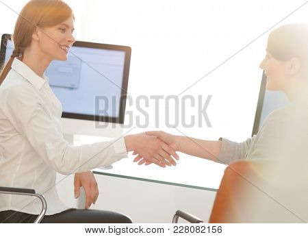 background image. business woman stretches out hand for a handsh