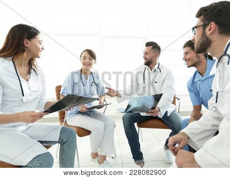 medical staff discussing x-ray of a patient
