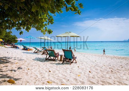 PHI PHI , THAILNAD-JAN 26, 2016: Umbrellas and sunchairs at Ao Loh Dalum beach at Phi Phi Don Island on Jan 26, 2016, Krabi Province Thailand.