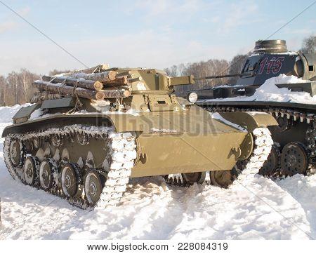 Vintage Old Tank On Snow In Winter