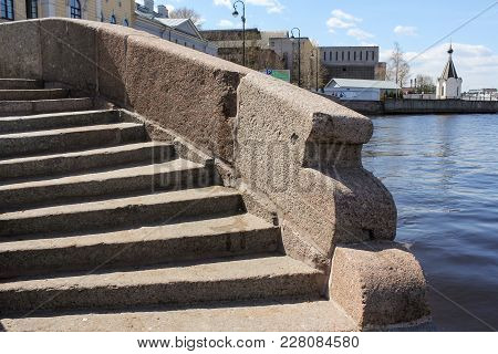 Old Granite Steps. Architecture Of Embankments Of Rivers And Canals Of St. Petersburg.