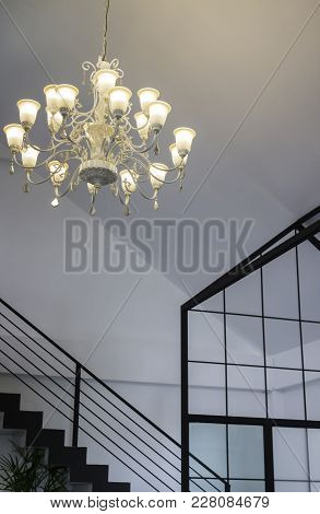 Vintage Chandelier Light Bulb In Dark Room, Stock Photo