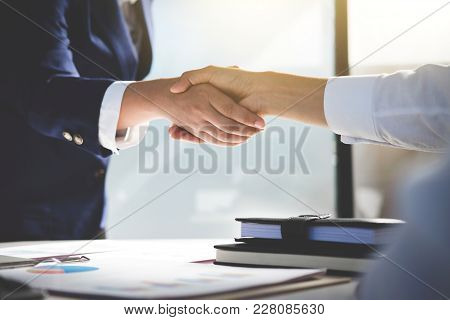 Teamwork Process, Image Of Business Team Greeting Handshake. Successful Business People Handshaking