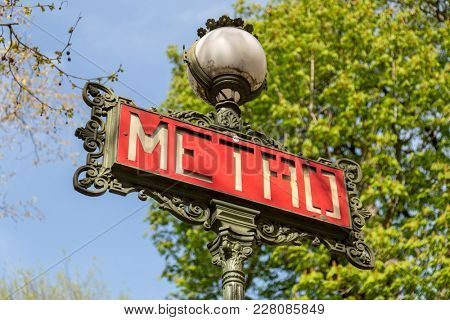 Art Nouveau influenced signs for the Paris Metro or Metropolitain, the underground rail system servicing Paris