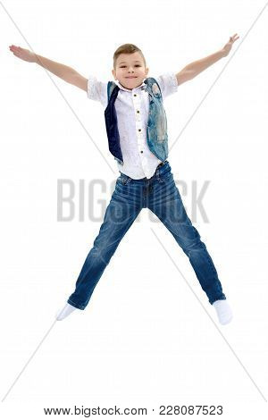 Little Boy Jumping Fun In The Studio On A White Background. The Concept Of A Happy Childhood, Sports