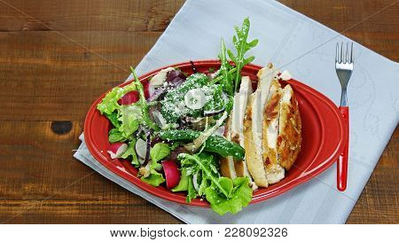 Juicy Seared Chicken Breast Sliced With Nutritious Green Leaf Vegetables, Arugula, Lettuce, Spinach,