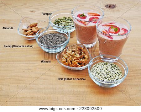 Two Glasses Of Yogurt Strawberry Smoothie With  Superfood Seeds And Nuts, Chia, Almond, Walnut, Hemp