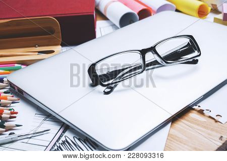 Close Up Of Glasses On Office Desktop With Other Items. Eyesight And Work Concept