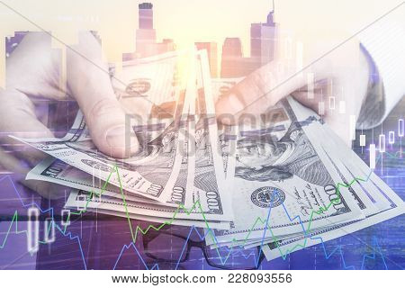 Businessman Counting Money Dollar Bills On Bright City Background With Sunlight. Finance And Rich Co