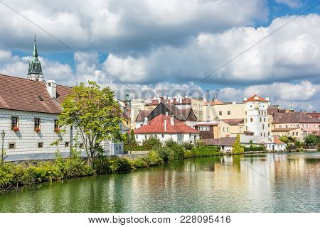 Historic Buildings With Reflections In Water Reservoir, Jindrichuv Hradec, Czech Republic. Architect
