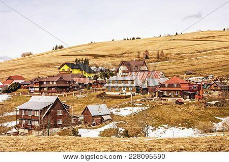 Folk Architecture In Zdiar Village, Slovak Republic. Travel Destination. Yellow Photo Filter.