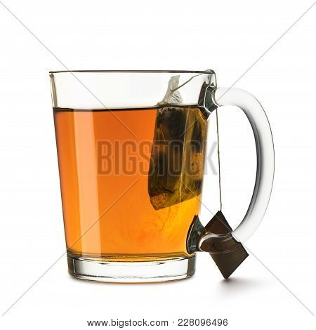Glass Cup Full Of Tea With Tea-bag Immersed, On White Background