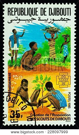 Moscow, Russia - February 22, 2018: A Stamp Printed In Djibouti Shows African Children Planting Sapl