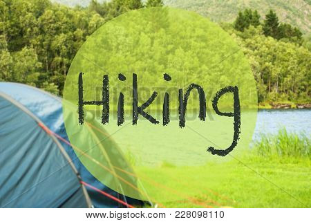 English Text Hiking. Camping Holiday In Norway At Lake Or River. Green Grass And Forest In Backgroun