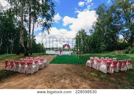 Wedding Arch And Chairs For A Beautiful Wedding Ceremony Outdoors