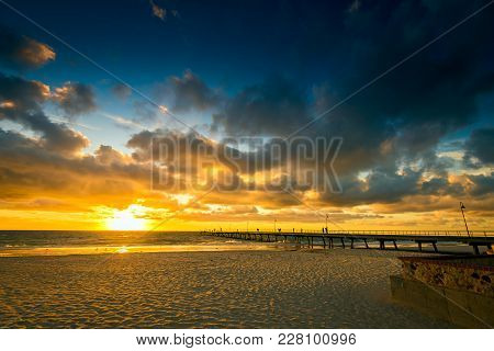 Glenelg Beach Jetty With People At Sunset