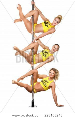 Beautiful Young Women Pole Dancers In Yellow Costumes With Get Ready Text On Them Training On Pylon.