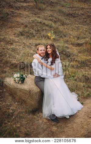 Stylish Couple Posing At The Wedding. Rustic Style. Groom With Beard