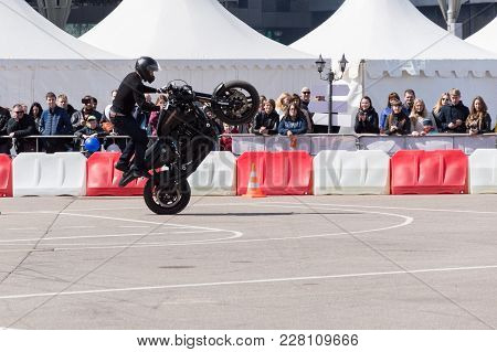Minsk, Belarus - April 24, 2016 Hog. Harley Owners Group Opening Driving Season Show. Man Stunt Ridi