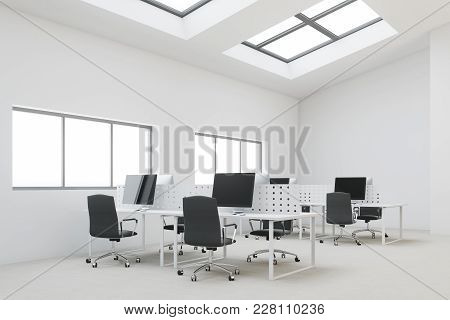 White Penthouse Open Space Office Corner With A Concrete Floor, Computer Desks And Windows In The Ro