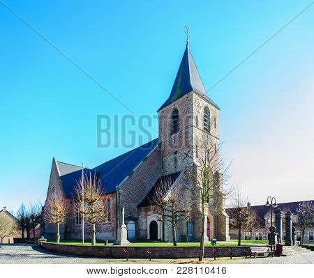 A Classic Church In The Flemish Town Of Schendelbeke. Image From A Sunny Winter Afternoon.