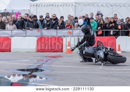 Minsk, Belarus - April 24, 2016 Hog. Harley Owners Group Opening Driving Season Show. Man Falling Do