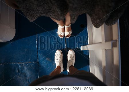 Love Story Told By Boots. Human Feet Close Up. Man And Woman In Sneakers. Woman Standing On Tiptoe T