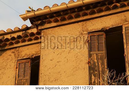 An Abandoned Derelict Mediterranean Building With Peeling Paint.