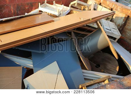 Various Pieces Of Wood In A Rusty Container