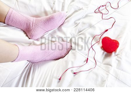T Legs In Pink Socks. Of The Girl Who Sitting In The Bed