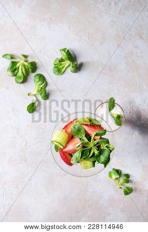 Spring Summer Diet Salad With Strawberries, Cucumber, Green Field Salad And Yogurt Mint Sauce Served