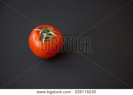 Spoiled Rotted Red Round Tomato On A Black Background Close Up